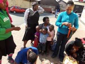 Zimbabwean women learning life skills on the street since they have no office space, Southern African Empowerment Initiatives: Zimbabwean Women in Exile in South Africa