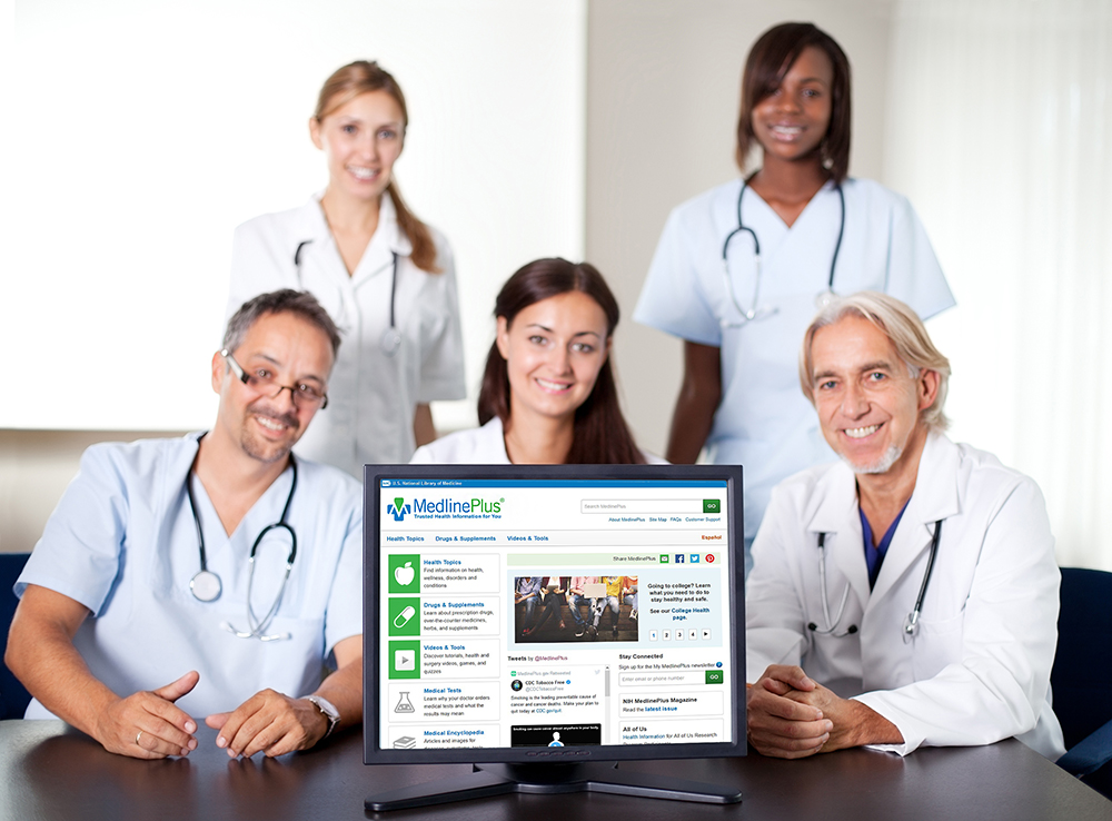 Doctors with a computer screen displaying MedlinePlus