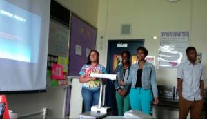 Class presentations of service learning projects to address health disparities in their communities