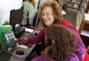 Wilma Krepps, Branch Manager of New Oxford Area Library teaching patrons how to use DIMRC
