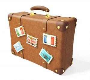 suitcase with international travel stickers