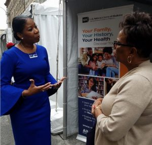 Dr. Dara Richardson-Heron talks about the All of Us Research Program at the National Library of Medicine booth