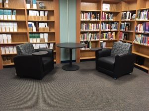 part of the redesigned library space featuring reading chairs and shelves