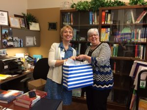 Renee Gorrell receiving prize from Barb Jones