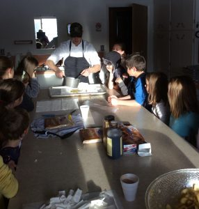 Photo of children at a cooking demonstration
