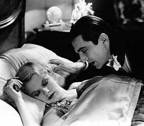 Dracula leaning over woman