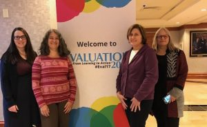 NEO staff in front of AEA banner. From left: Kalyna Durbak, Karen Vargas, Cindy Olney, Susan Wolfe