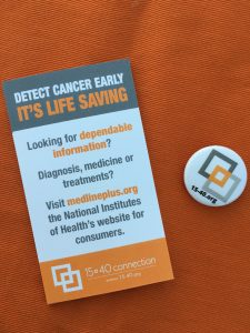 business card and button from 15-40.org