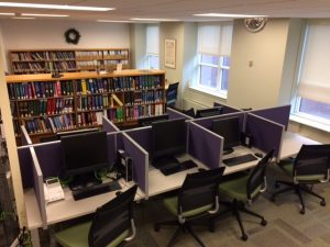 library computers and shelves of books