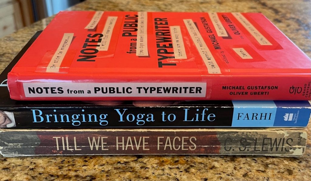 This book spine poem reads: Notes from a Public Typewriter, Bringing Yoga to Life, Till We Have faces