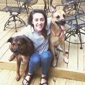 Nicole Klein sitting with her two dogs