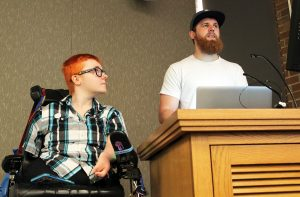 K Wheeler and Shawn Berg demonstrate screen reader software from a podium at the front of a UW classroom