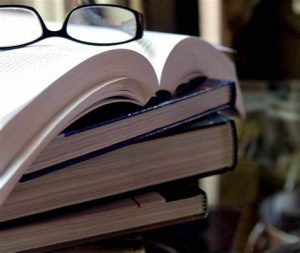 Books with reading glasses
