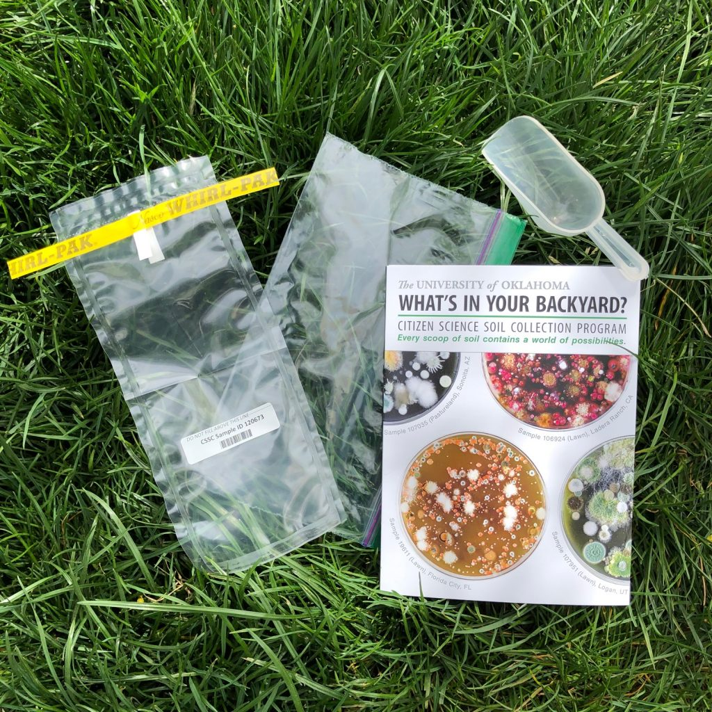 What's in your Backyard citizen science kit. Includes a scoop, instructions for participating, and two plastic bags