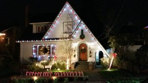 house with holiday lights and decorations